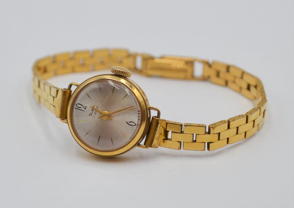 Золотые часы 750 пробы